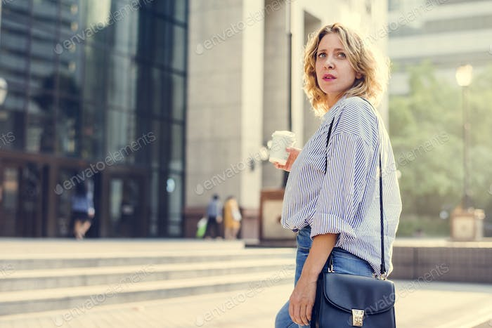 Woman standing with a cup of coffee