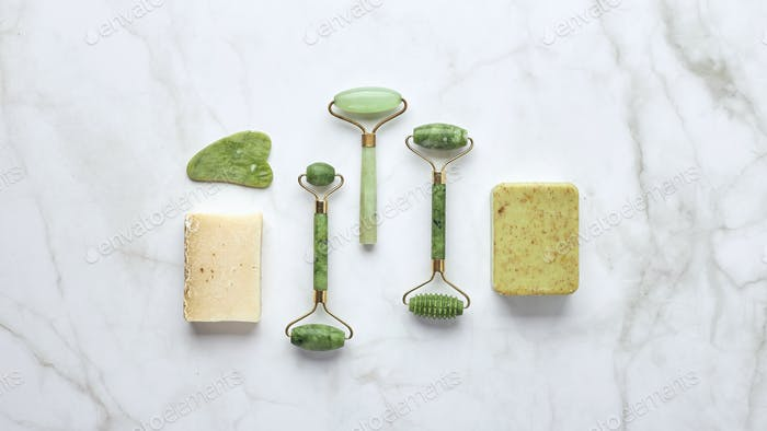 Cosmetic skin care products, jade stone face massager, creams, gel and oil.