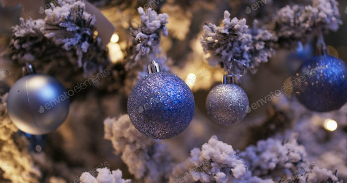 Christmas tree decoration with light in blue color at night