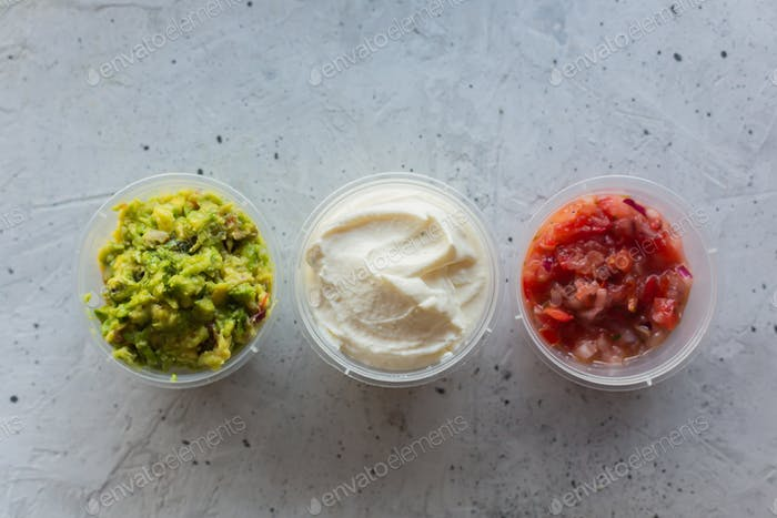 Traditional mexican sauces on the gray concrete background