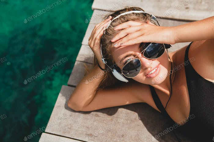 young slim woman laying on pier