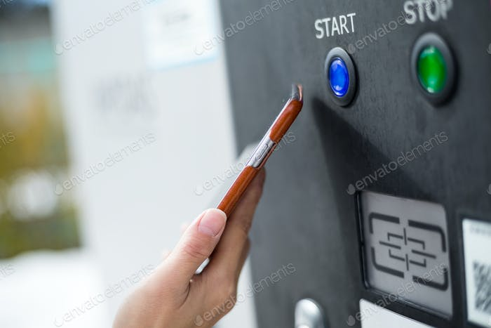 Customer paying with NFC technology on parking system