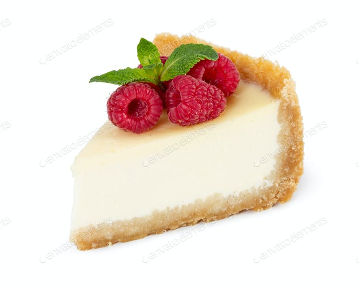 Piece of cheesecake with raspberries and mint isolated on white