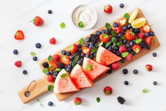 fruit and berry platter over white. blueberry, strawberry, raspb