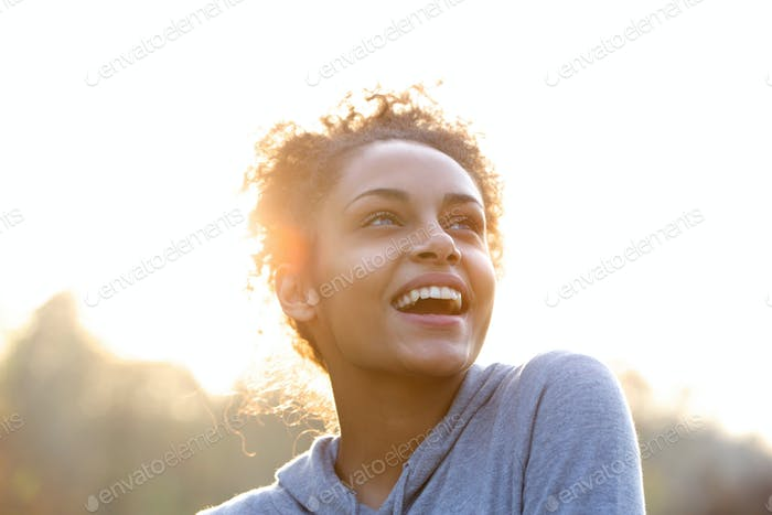Attractive young woman laughing and looking up