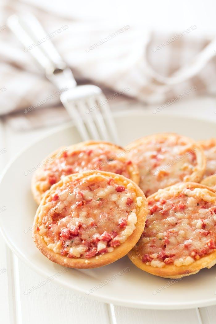 mini pizza on plate