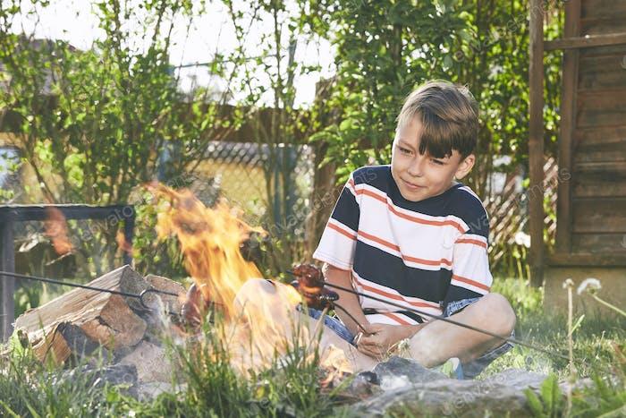 Boy enjoy campfire