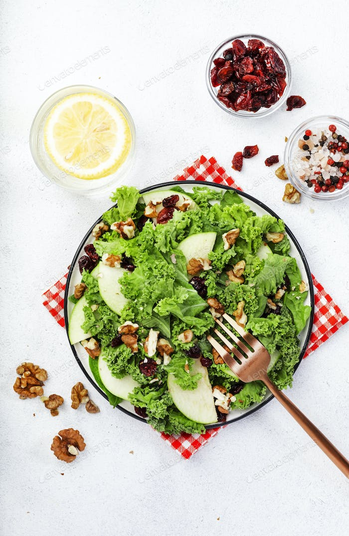 Kale salad with dried cranberry, green apples and walnuts