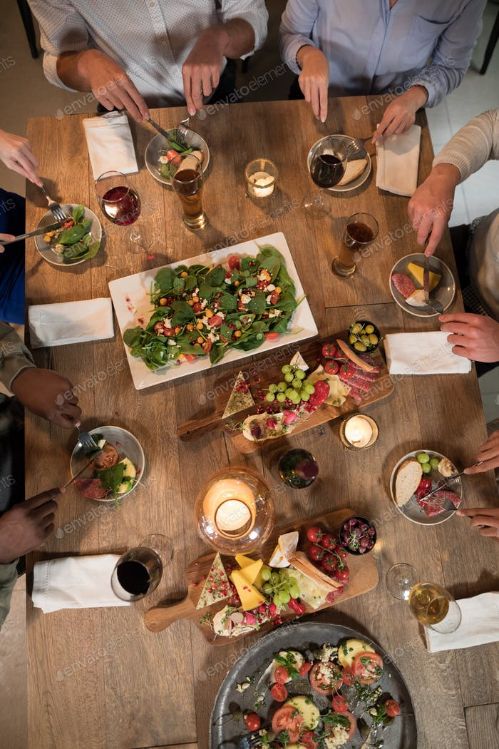 Overhead of friends dining together