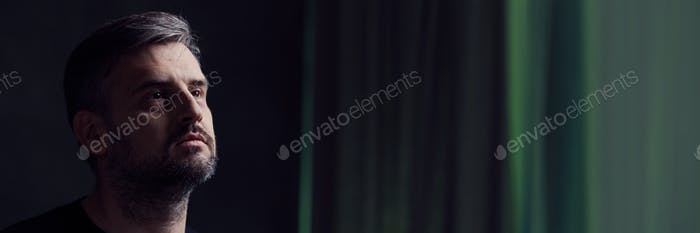 Widower in dark room