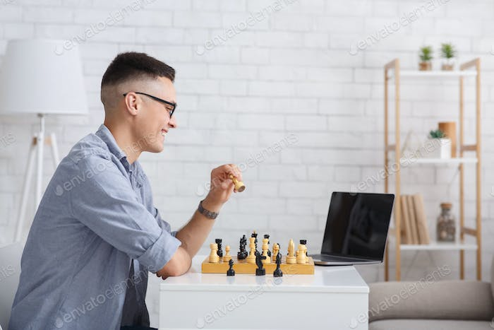 Free time, leisure and hobbies. Man teaching play chess remotely