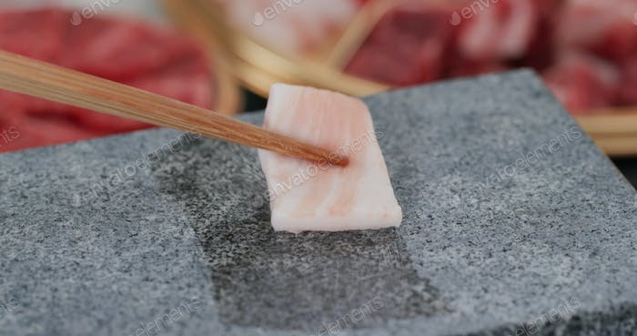 Grill beef on the hot stone