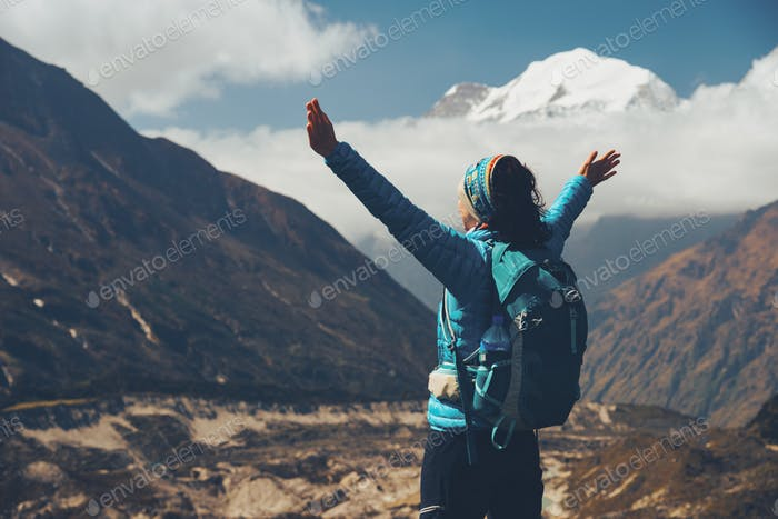 Woman with backpack and raised up arms. Vintage