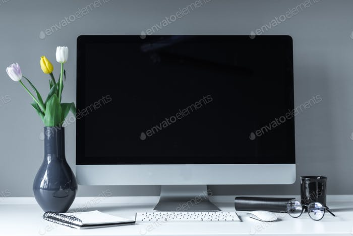 vase with tulips on white working table