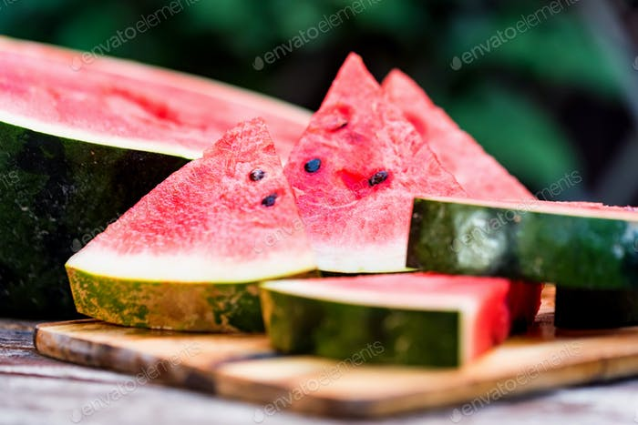 Slices of fresh watermelon on wooden board