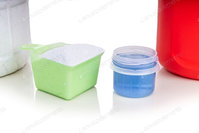 Close-up comparison of powder and liquid laundry detergent against white backgound