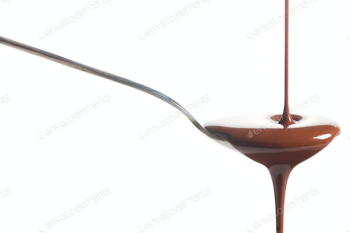 Chocolate poured into a spoon