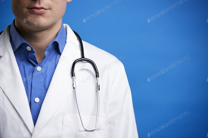 Young white male doctor with stethoscope, cropped portrait