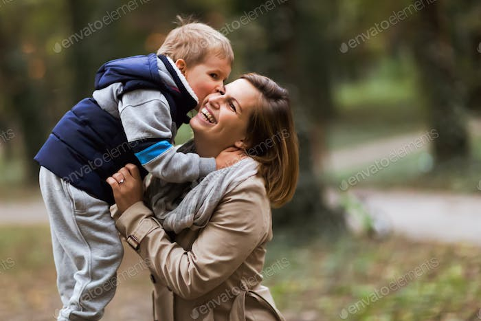 Happy mother and child smiling