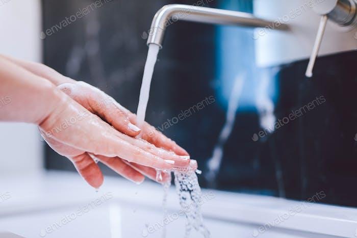 Washing hands with foam soap. Hygiene, preventing coronavirus