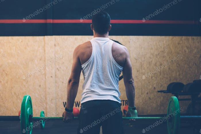 Male athlete doing deadlift exercise
