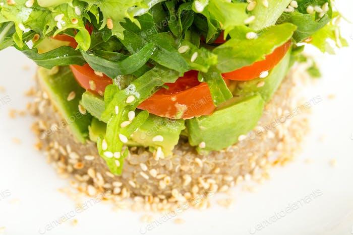 Quinoa salad with avocado and cherry tomatoes.