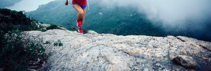 Ultra marathon runner running to mountain top