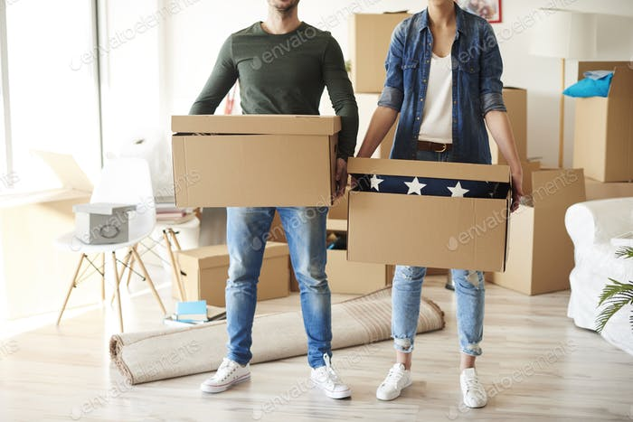 Front view of couple with cardboard boxes