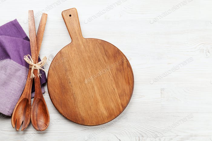Cutting board over wooden table
