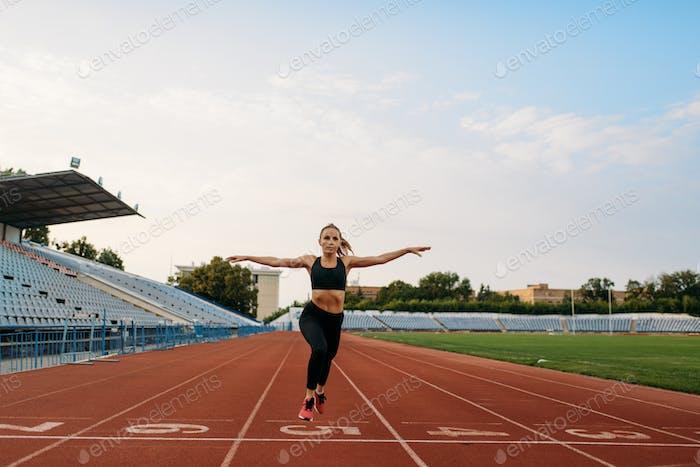 Female jogger in sportswear crosses finish line