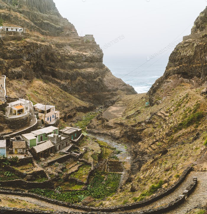 Settlement in the rocky coast of Santo Antao island. Houses nestle into the sides of bluff ridge