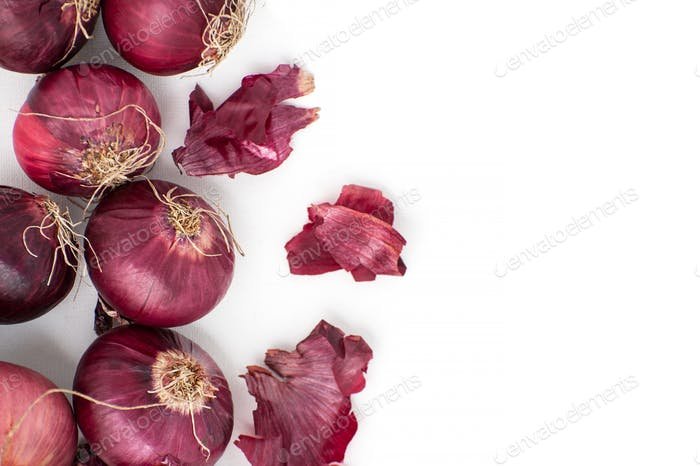 Red onion and peel close-up on a white background.