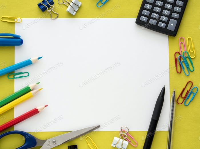 Colorful stationery on yelow background