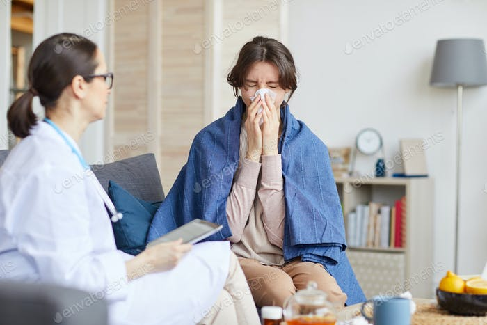 Sick woman talking to doctor