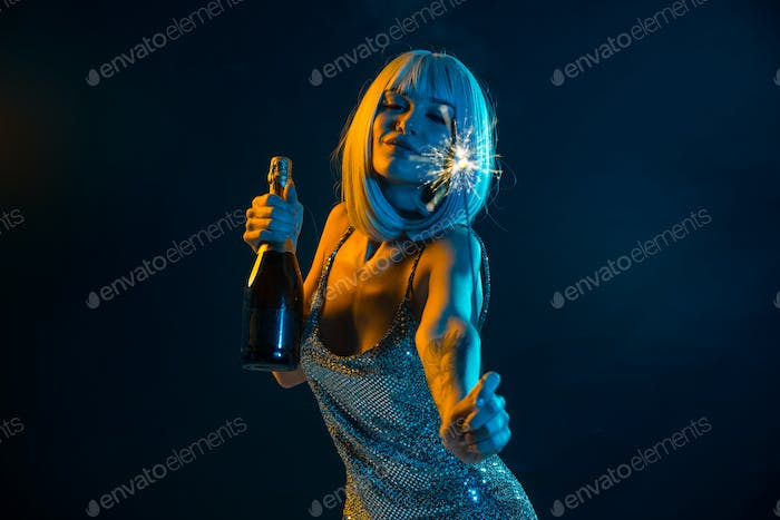 Young woman with grey hair dancing and celebrate