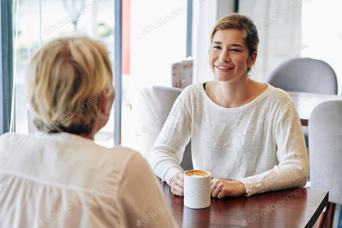 Woman meeting in coffeeshop with mother