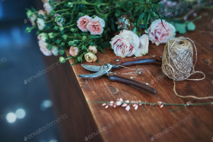 Beautiful flowers and garden tools