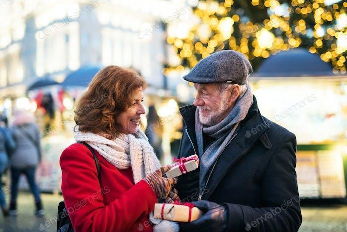 Senior couple on an outdoor Christmas market.