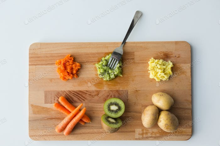 mashed fruits and vegetables with forks on board