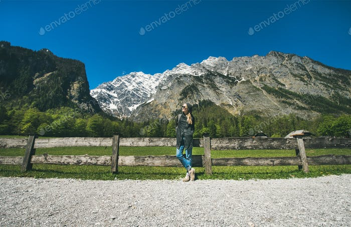 Female traveller posing in front of mountain view of Alps