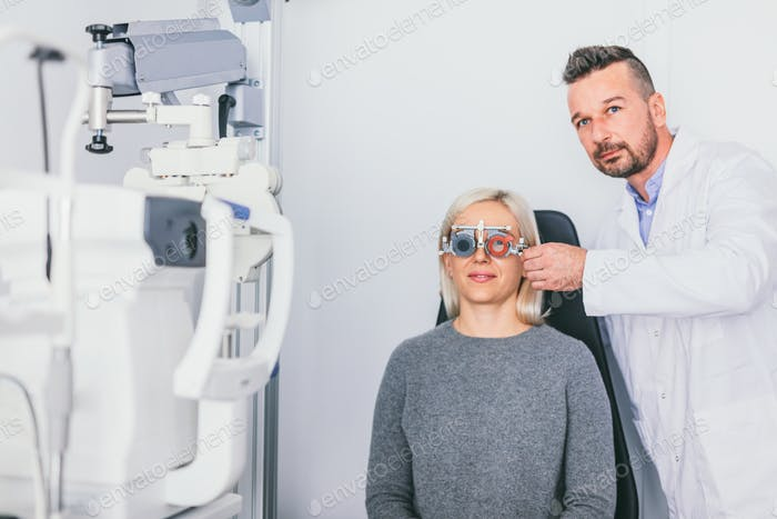Doctor checking his patients eyesight