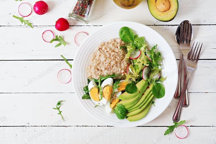 Healthy breakfast. Dietary menu. Oatmeal porridge and avocado salad and eggs. Top view