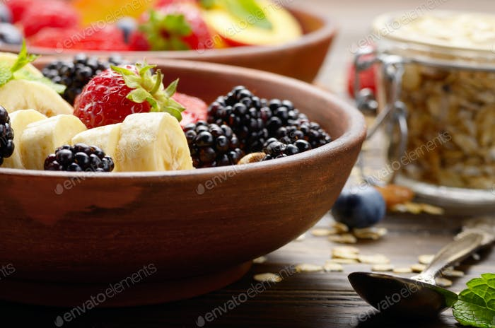 Fruit healthy muesli with banana strawberry almonds