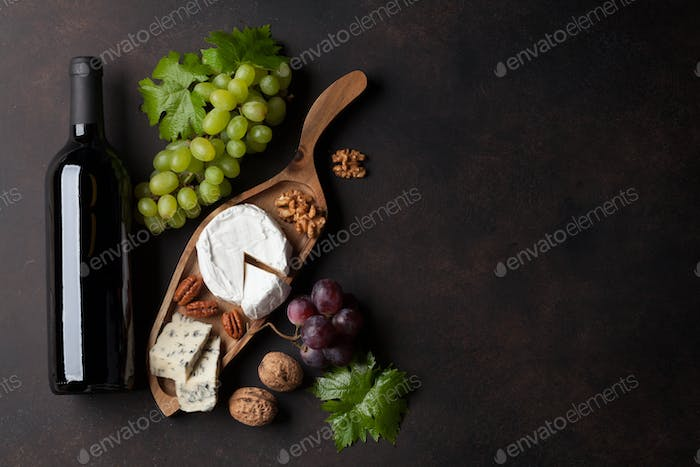Wine bottle, grape and cheese