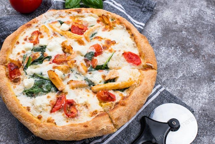 Italian pizza with tomato, mozzarella and chicken