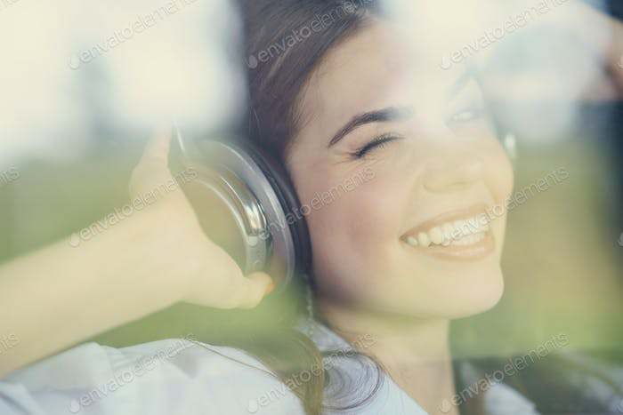Pretty young girl listen to music