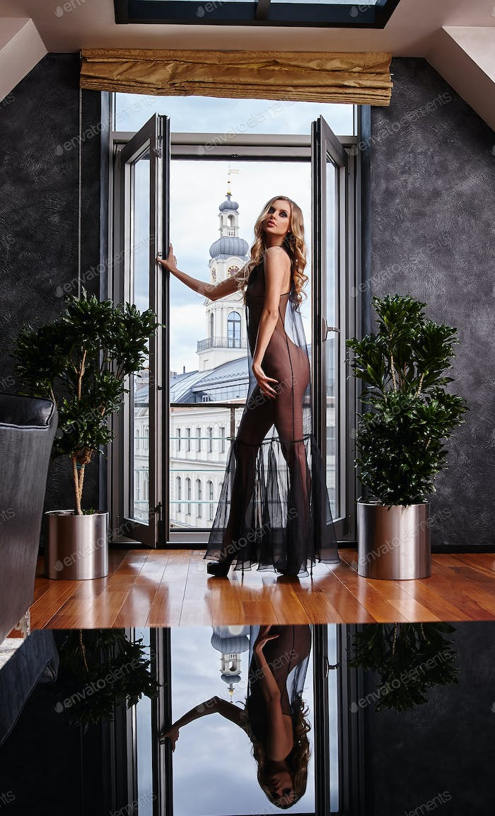 Sexy blond woman in transparent dress.