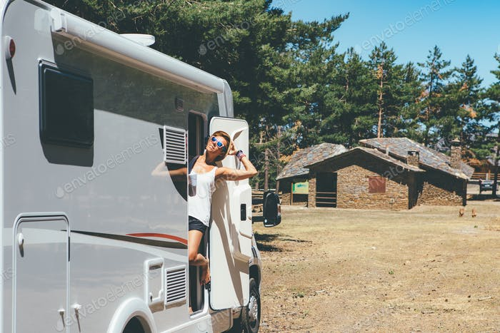Happy girl relaxes on a motor home