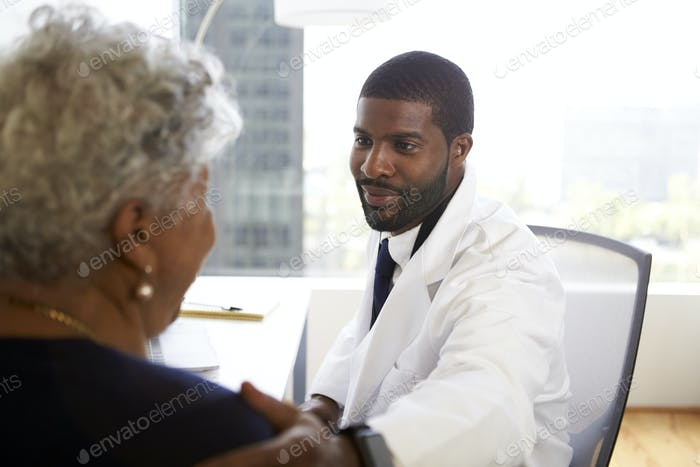 Senior Woman Meeting With Male Doctor Cosmetic Surgeon In Office