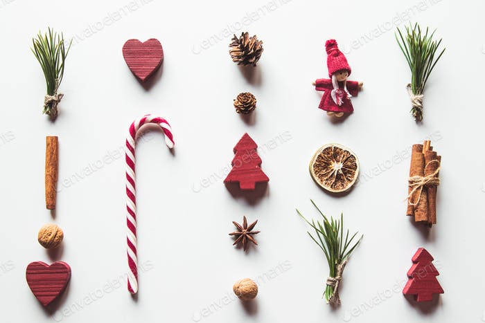 christmas candy canes with toys isolated on white background, flat lay, top view